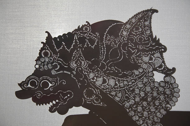 traditional indonesian shadow puppet theatre wayang kulit - wayang kulit stock photos and pictures