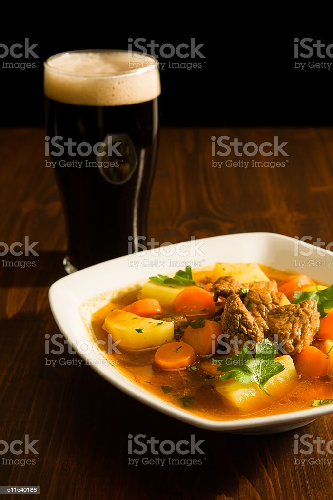 Traditional Irish Stew and a pint of beer stock photo