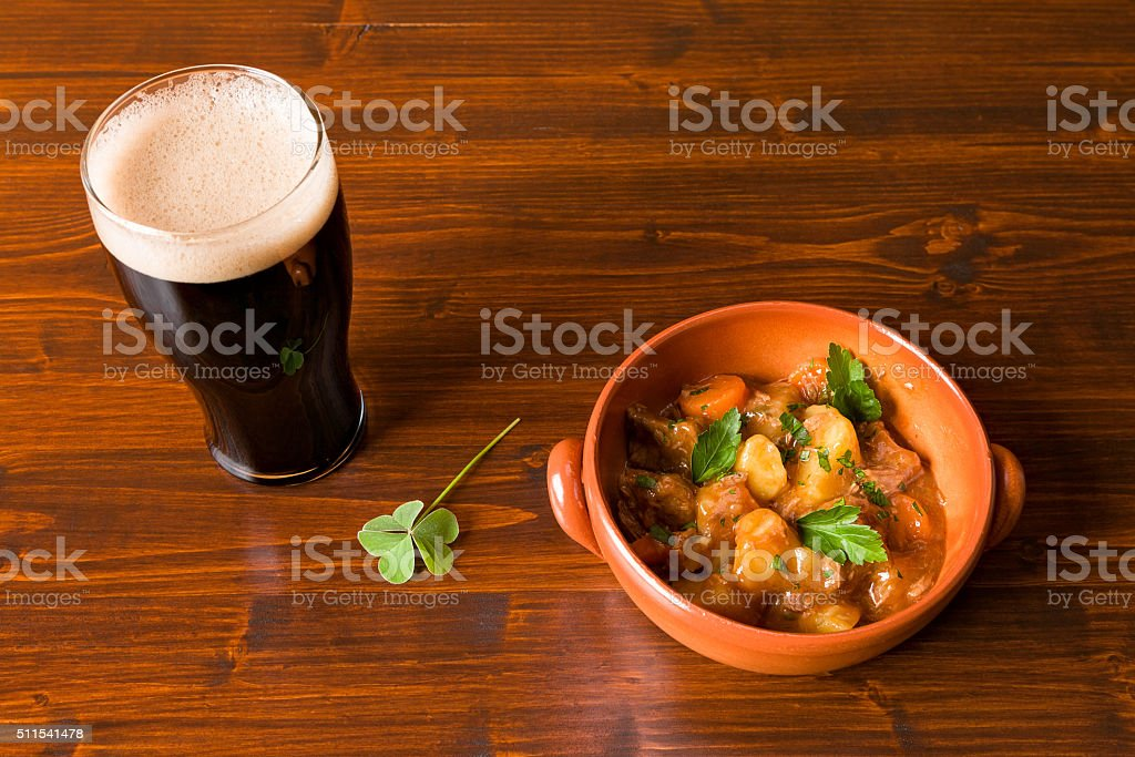 Traditional Irish Stew and pint of beer and a shamrock stock photo
