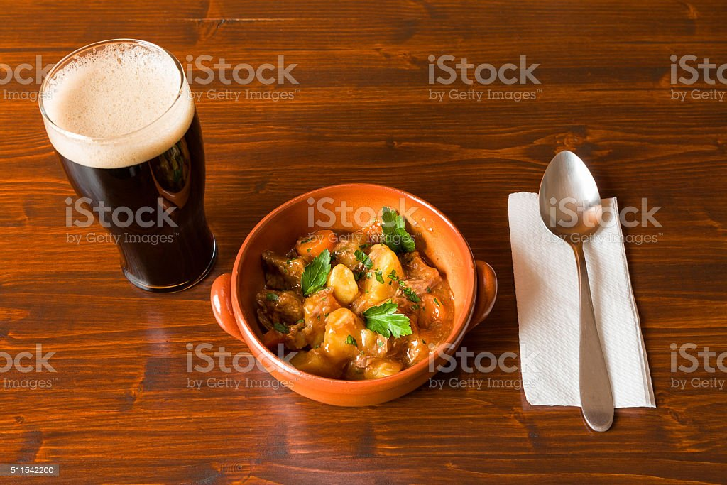 Traditional Irish Stew and pint of stout beer and spoon stock photo