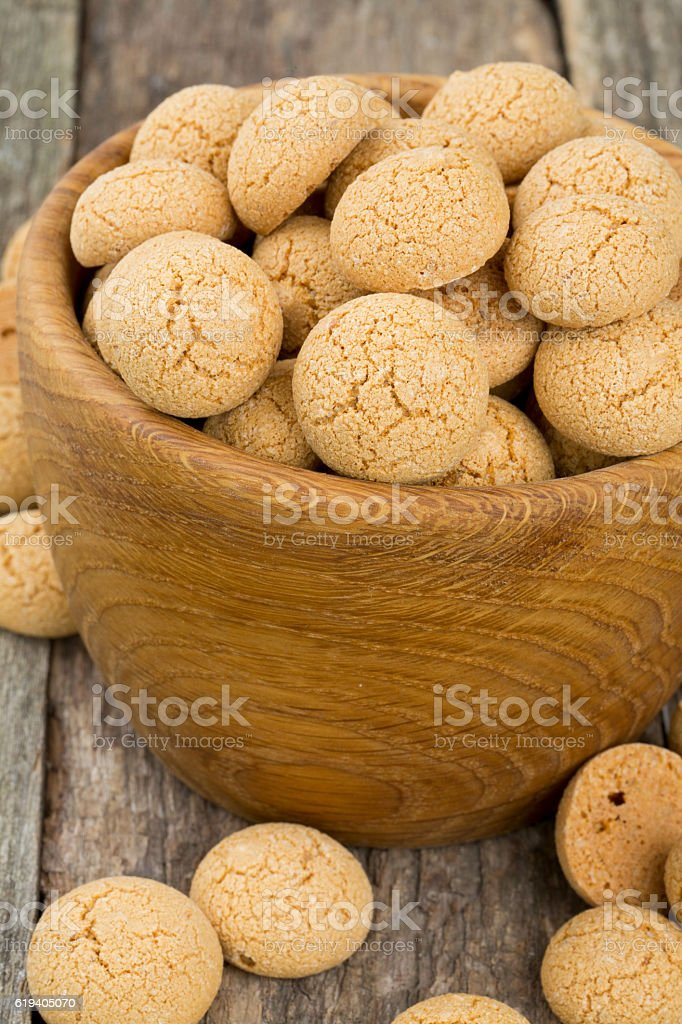 Traditional italian almond cookies - amaretti, on wooden surface stock photo