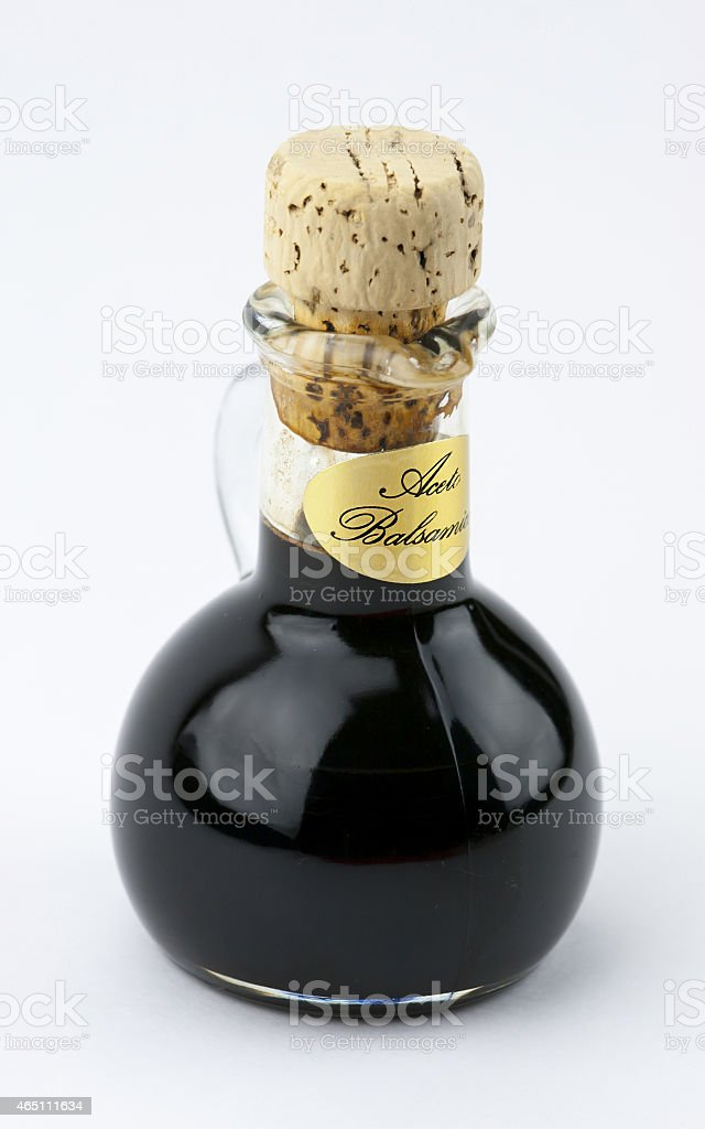 Traditional italian balsamic vinegar isolated on white backgroun stock photo