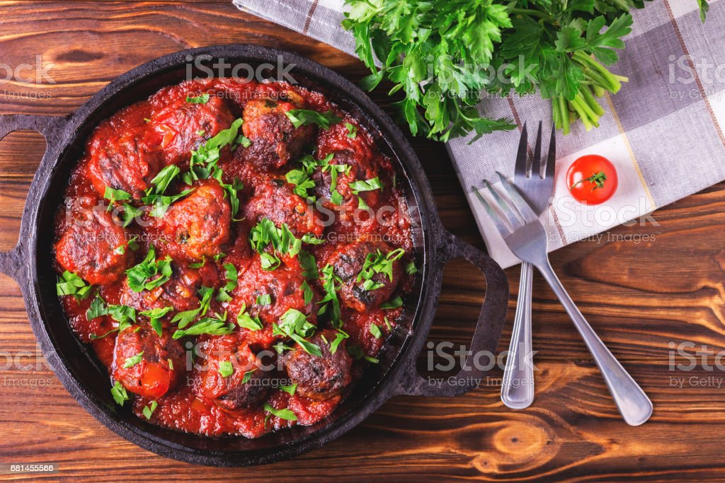 Traditional Italian beef meatballs, tomato sauce and parsley royalty-free stock photo