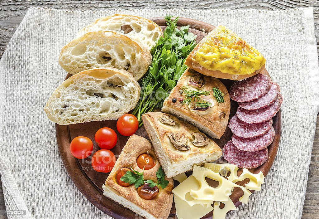 Traditional italian bread with cheese and salami royalty-free stock photo