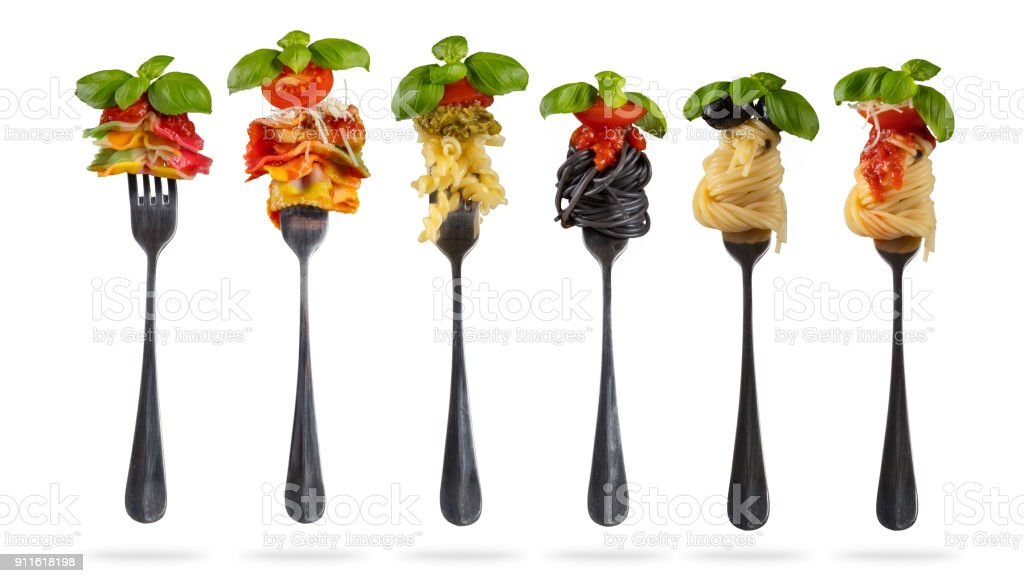 Traditional italian collection of pasta warpped on fork. stock photo