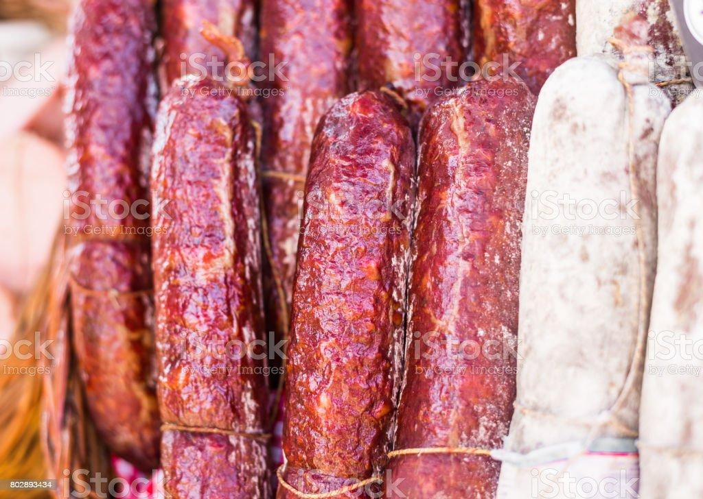 Traditional Italian delicatessen salami sausage stock photo