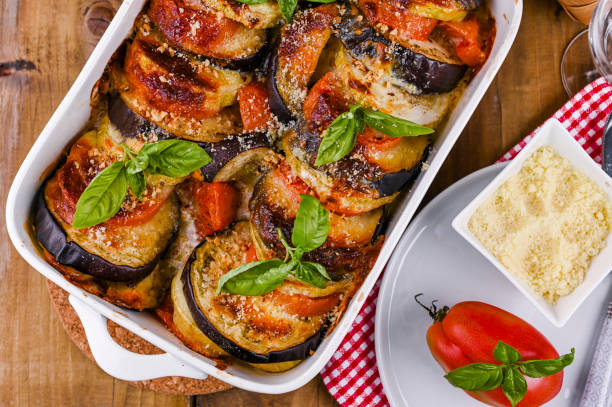 traditional italian food. baked eggplant, tomatoes with sauce, parmesan and basil. rustic food for a healthy diet. vegetables for lunch. - melanzane foto e immagini stock