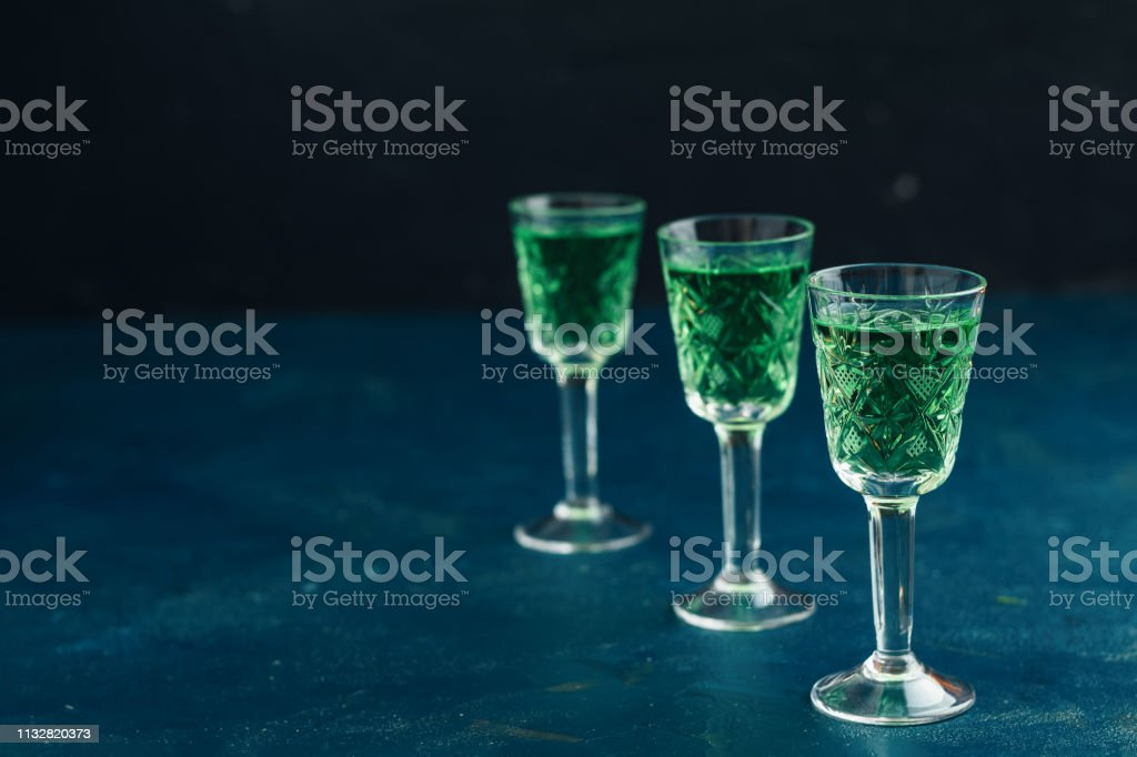 Traditional italian or czech liqueur or bitter with fennel. Three absinthe glass stock photo
