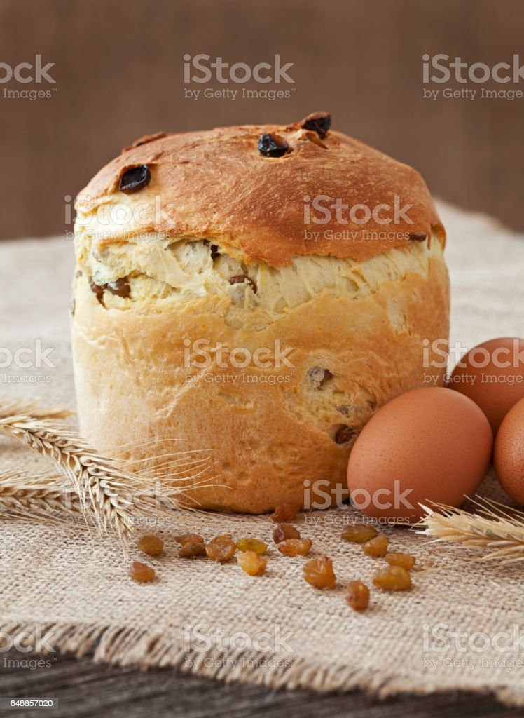 Traditional Italian panettone easter holiday cake sweet bread also called kulich with raisins and eggs. stock photo