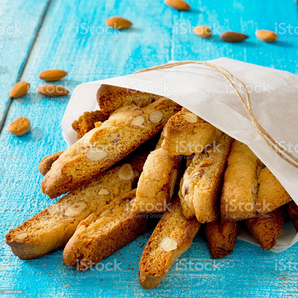 Traditional Italian pastry biscuit (cantuccini) on a wooden tabl stock photo