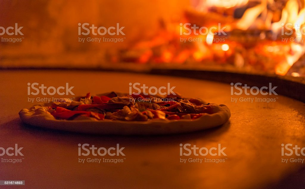 Traditional Italian pizza in the wood oven stock photo