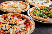 istock Traditional Italian pizza on a dark background top view 1176852339