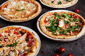 istock Traditional Italian pizza on a dark background top view 1210321940