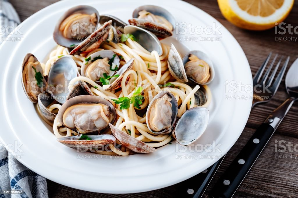Traditional italian seafood pasta with clams Spaghetti alle Vongole stock photo