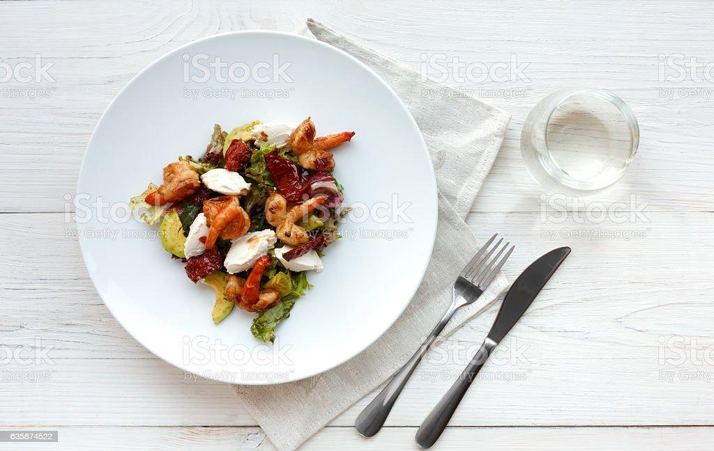 Traditional italian seafood salad with shrimps and mozzarella