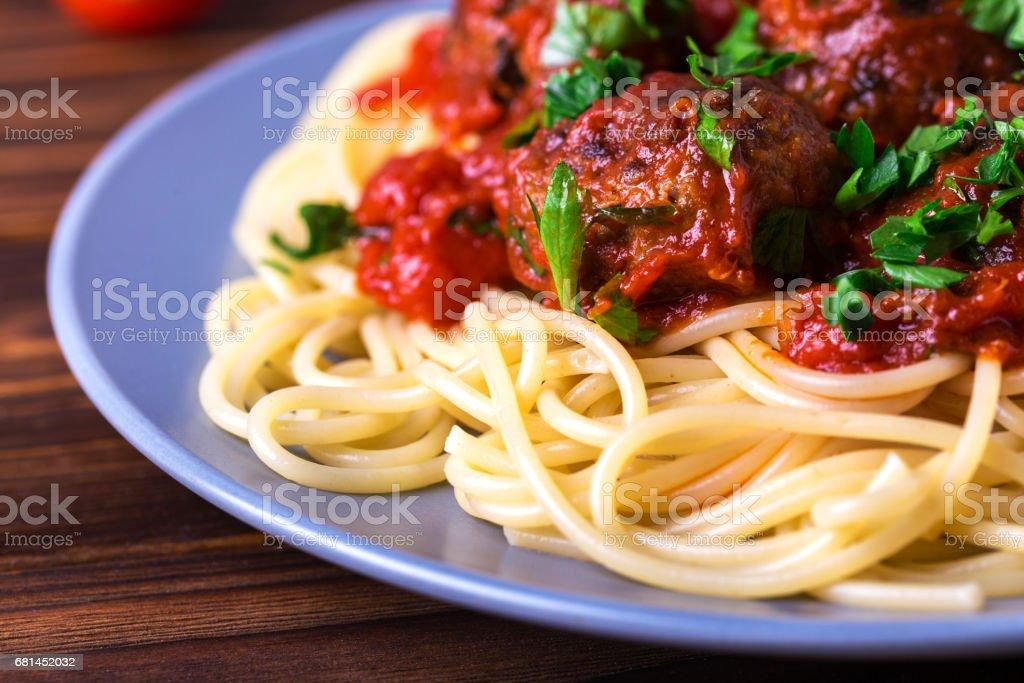Traditional Italian spaghetti pasta with beef meatballs royalty-free stock photo