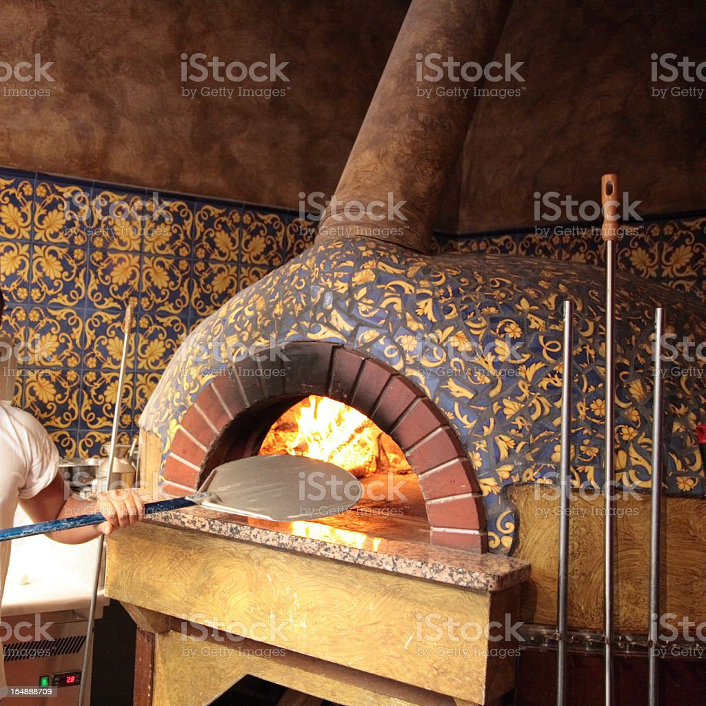 Traditional italian wood burning pizza oven stock photo
