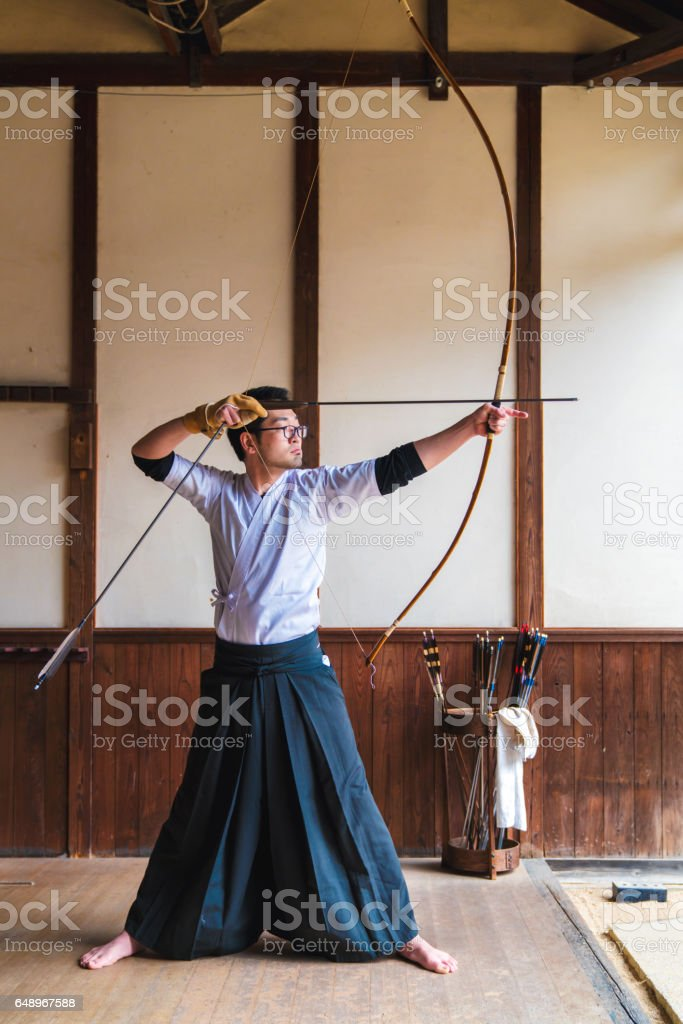 Traditional Japanese archer takes aim stock photo