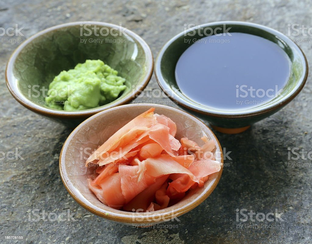 traditional Japanese condiments - wasabi, ginger and soy sauce stock photo