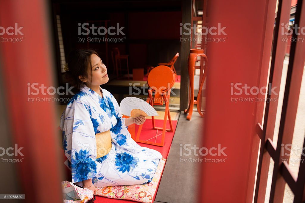 Japanese woman dressed in a traditional yukata in a tatami room