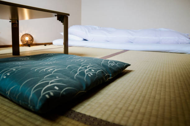 Traditional Japanese Ryokan room with tatimi mats and futon, Japan stock photo