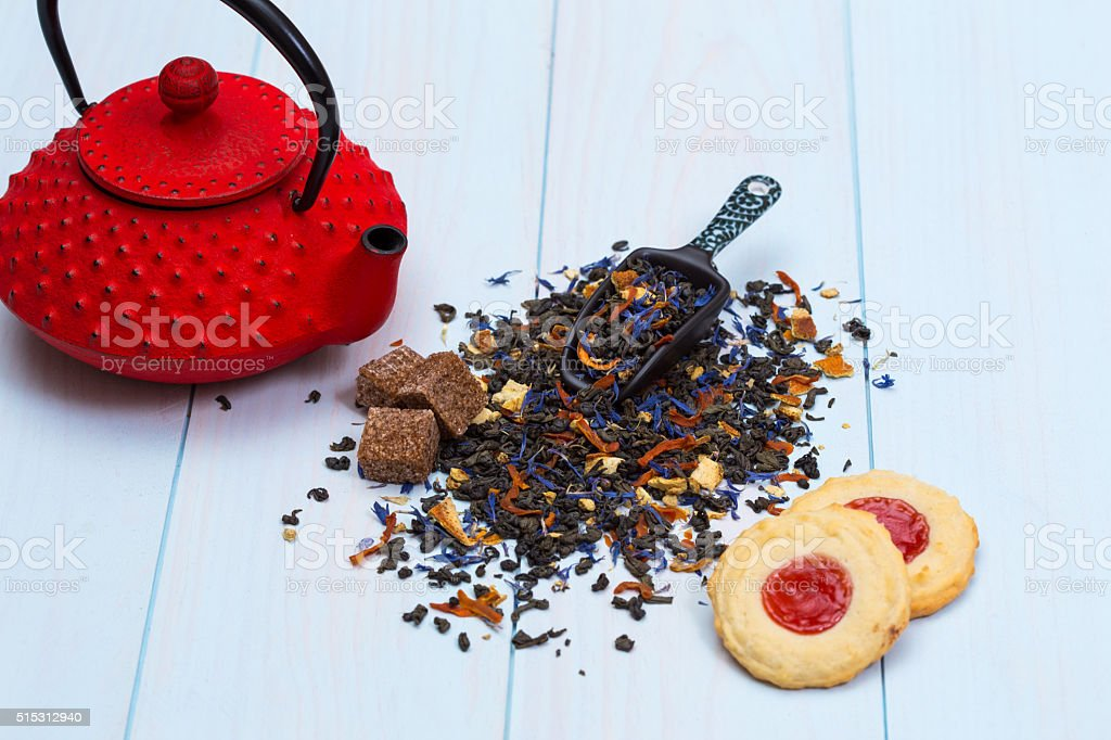 Traditional Japanese teapot, tea leaves and cookies stock photo