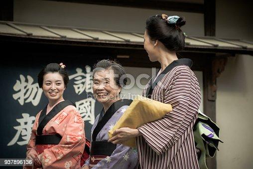 istock Traditional Japanese village from 19th century - geisha women 937896136