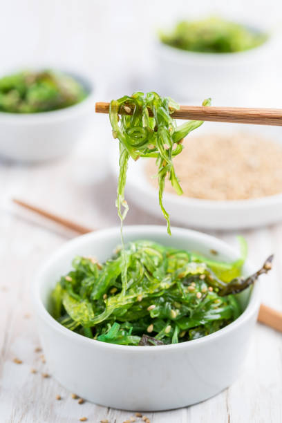 Traditional Japanese wakame salad with sesame seeds. Healthy and fresh seaweed salad. stock photo