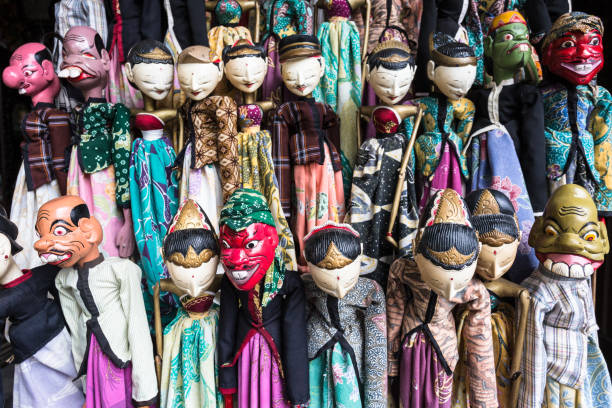 traditional javanese wooden puppets in jakarta flea market - wayang kulit stock photos and pictures