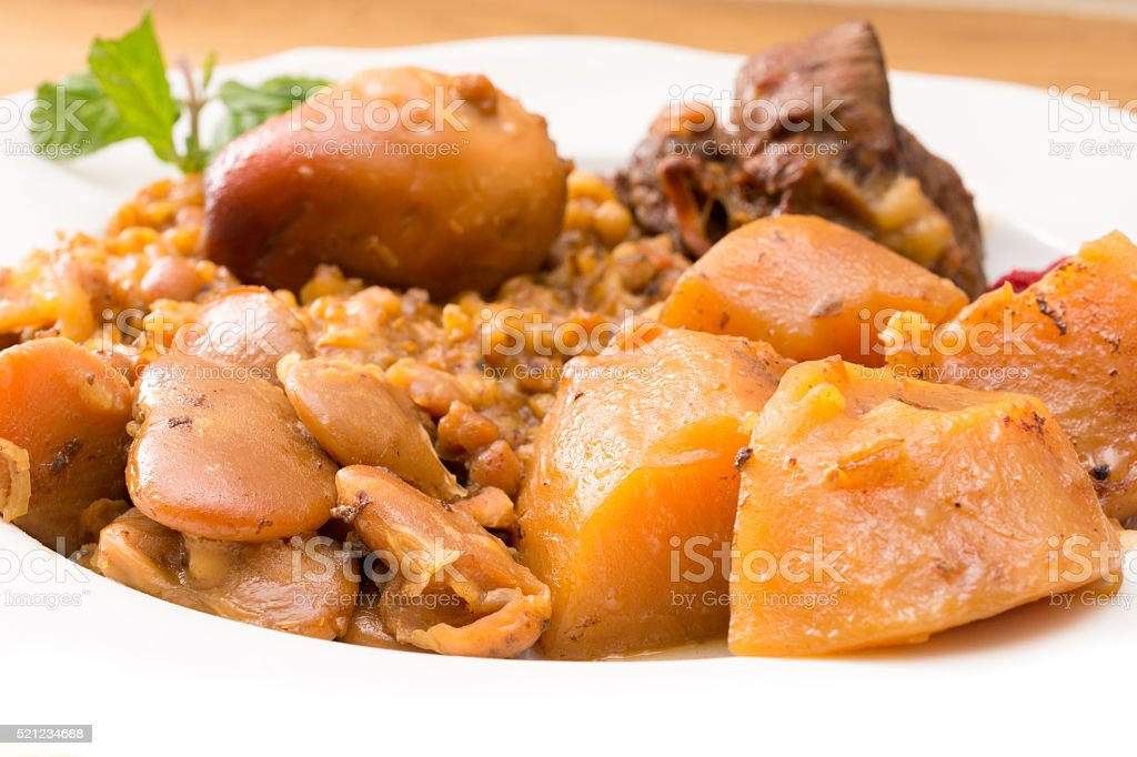 Traditional Jewish Cholent (Hamin) from Israel served with horse stock photo