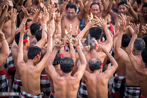 Bali, Indonesia - April 3, 2015: The Kecak dance in Bali is a traditional and highly spiritual dance; it takes place at the tipping end of the island, at the famous temple of Uluwatu and attracts today thousands of visitors everyday.