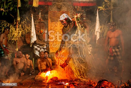 Bali, Indonesia - October 2015: men walking over fire during Traditional Kecak fire Dance performance in temple Bali, Indonesia