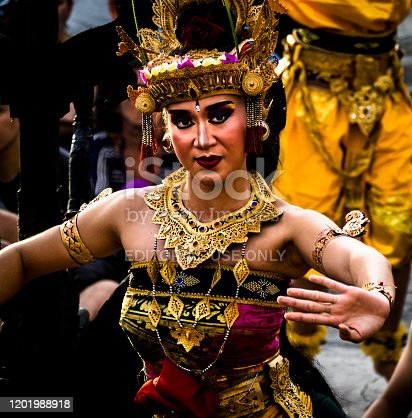 Bali, Indonesia - Januari, 2019: Bali Kecak and Fire Dance is Traditional Balinese Dance with story from fragment Ramayana and highly spiritual dance, it takes place at the tipping end of the island, at the famous temple of Uluwatu and attracts today thousands of visitors everyday.