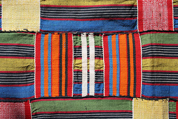 traditional kente cloth from ghana - kente cloth stock photos and pictures