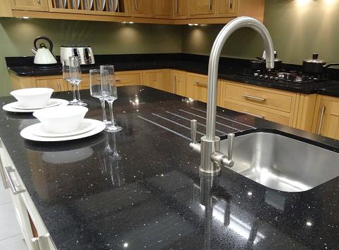Traditional kitchen, black granite worktop counter island, cupboards