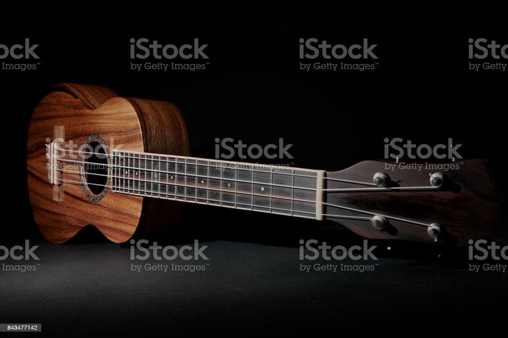 Traditional koa wood ukulele. Hawaiian uke musical instrument. stock photo