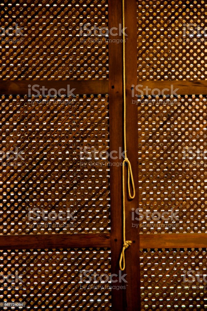traditional lattice window and rope hanging.Andalucia stock photo