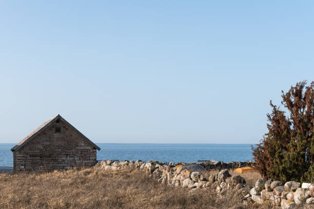 Traditional limestone cabin by the coast stock photo