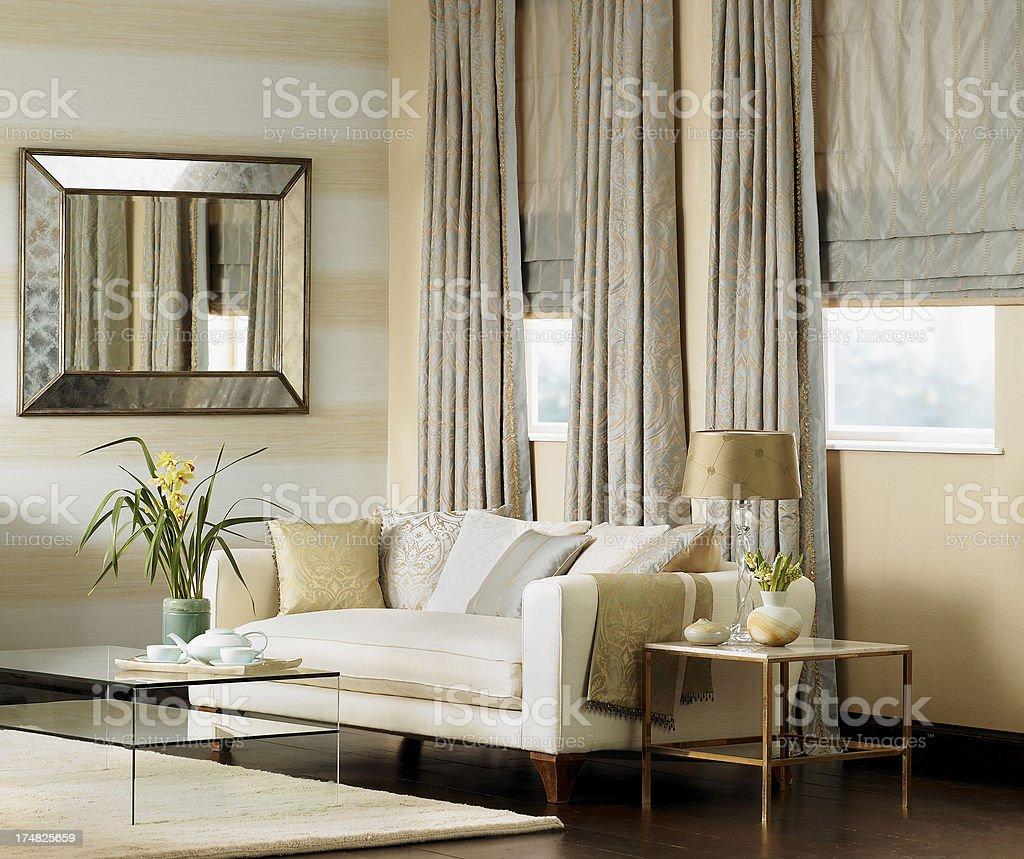 Traditional living room interior with cream sofa stock photo