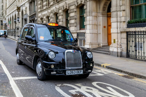 Traditional London black hackney cab or carriage in an empty street in central London, United Kingdom stock photo