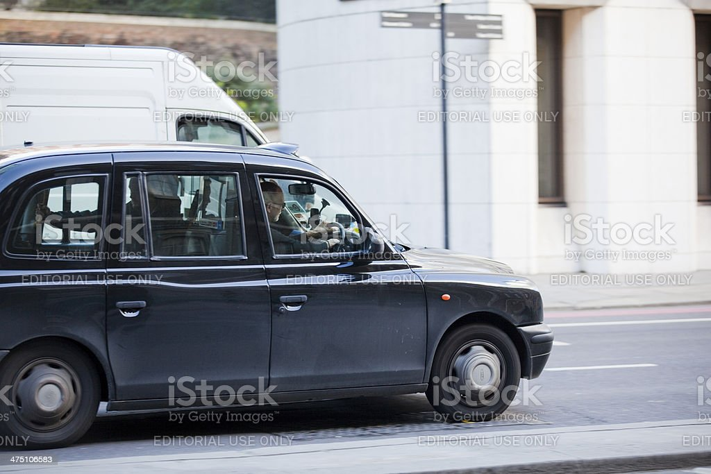 Traditional London black taxi cab stock photo