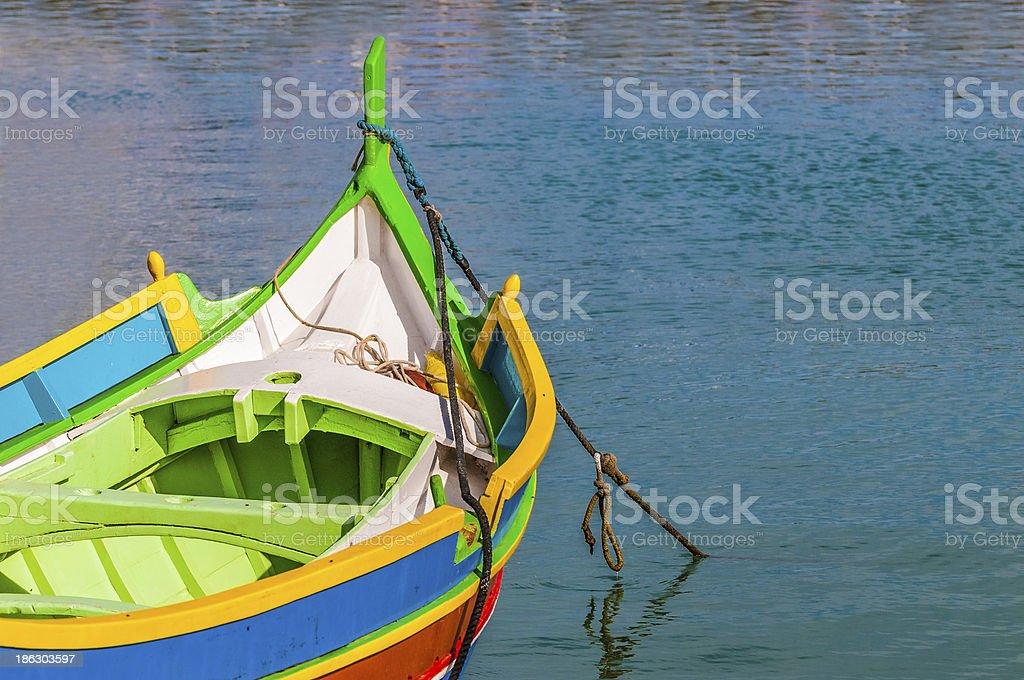 Traditional Luzzu boat at Marsaxlokk harbor in Malta. stock photo