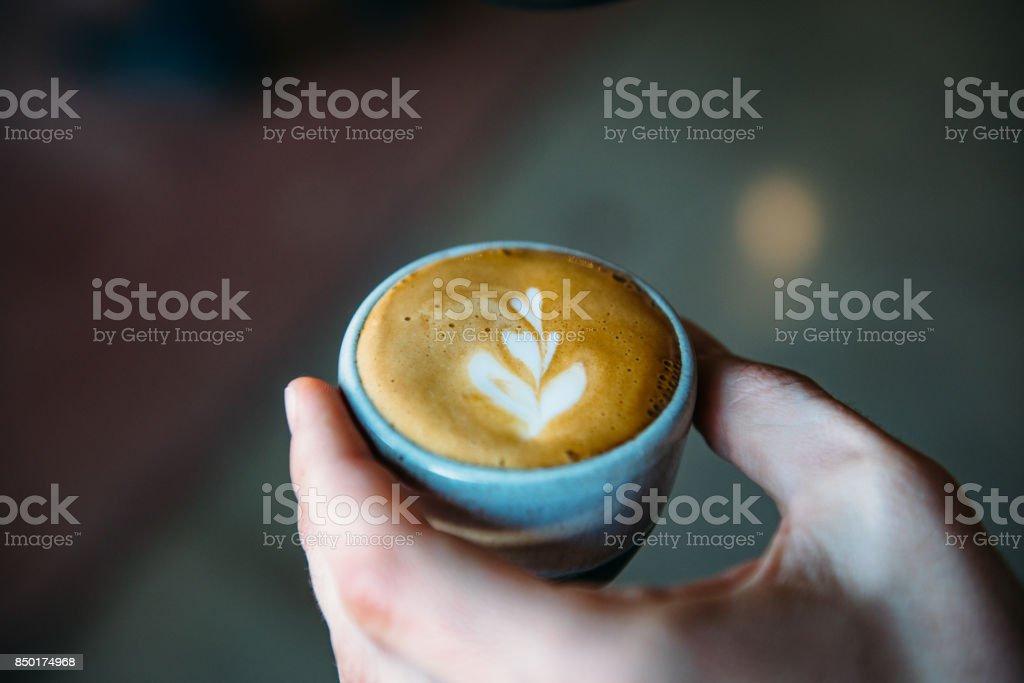 A Traditional Machiatto In Hand stock photo