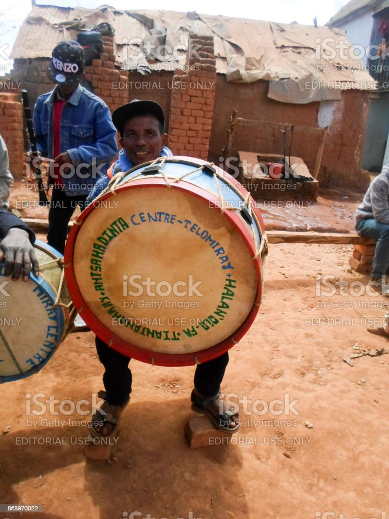 A traditional Malagasy musician posing with his drum during the rite of 'famadihana' (exhumation) in the highlands stock photo