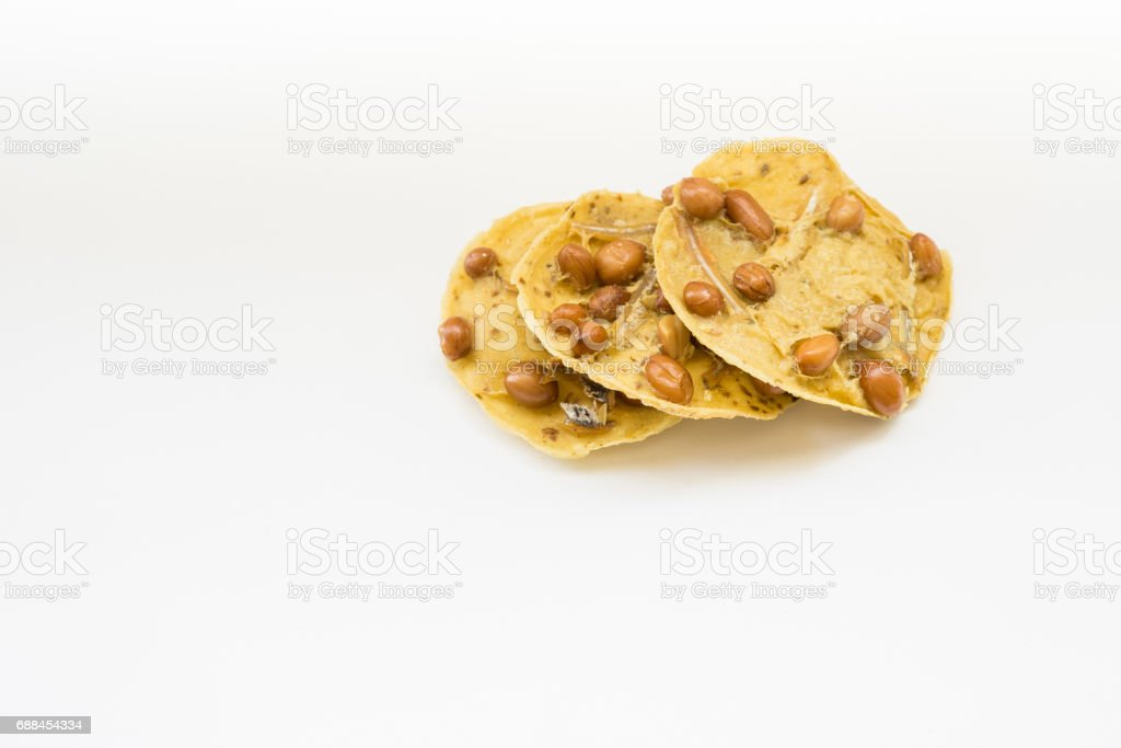Traditional Malaysian cookies snack called ' Kuih Rempeyek ' over white background stock photo