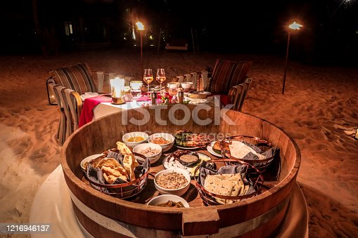 Traditional Maldivian Beach Dinner with a Malafaai barrel. Food selection with authentic Maldivian foods such as Roshi, Mashuni, Masroshi, Masriha, Prawns and Curries with Salads.