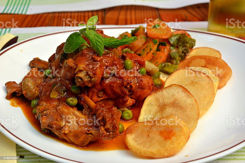 Traditional Maltese rabbit stew. stock photo
