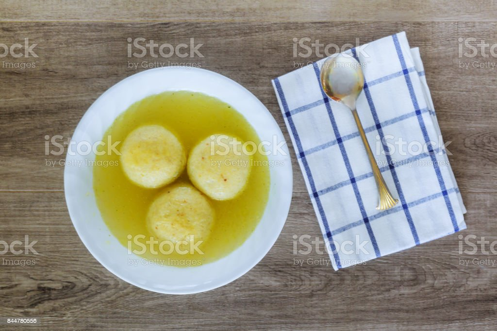 Traditional Matzah Ball Soup for Jewish Passover stock photo