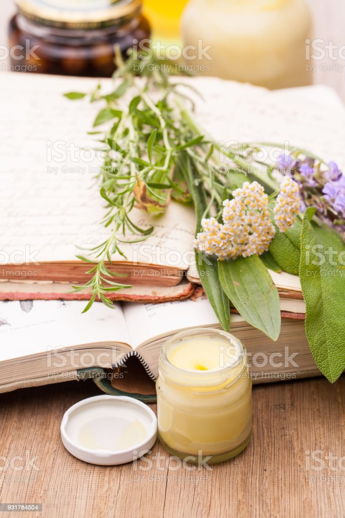 Traditional Medicinal Plants Books And Medical Creams Stock Photo
