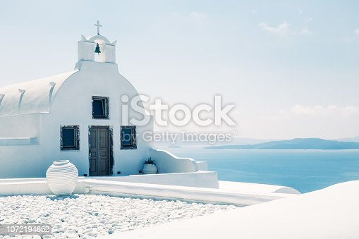 Traditional mediterranean white church in minimalistic design and bright colors, Oia, Santorini, Greece, Europe